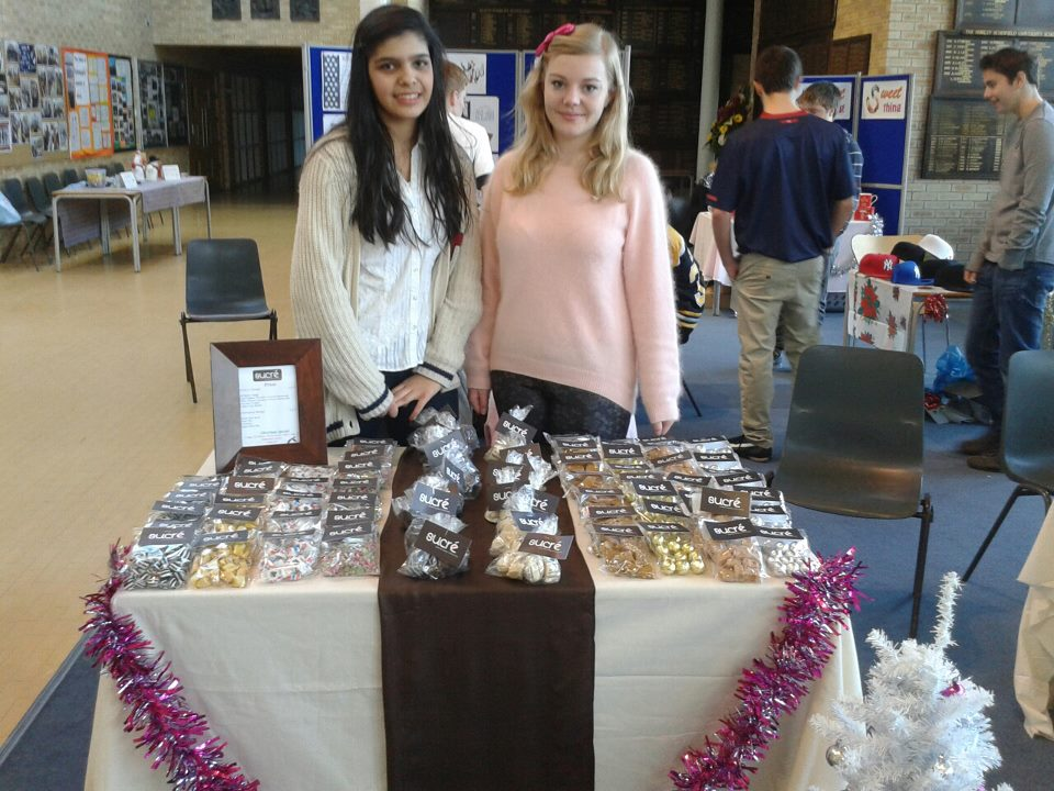 Anam and Elinor selling our products in aid of sending GSAL students to help in Malawi!