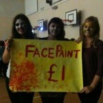 Kristi, Rhonwen, and Elinor face painting to fundraise.