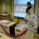 Anam selling sweeties to the public!